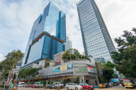 Hong Kong - 2020: Exchange Tower and One Kowloon, modern buildings, cars on the street.