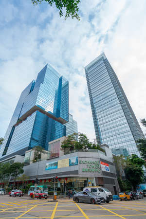 Hong Kong - 2020: Wang Chiu Road and Lam Fung Street, crossroad near Exchange Tower, One Kowloon skyscraper.