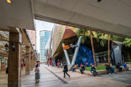 Hong Kong - 2020: people near the MCL Cinemas Telford, building exterior, sign, Kowloon Bay.