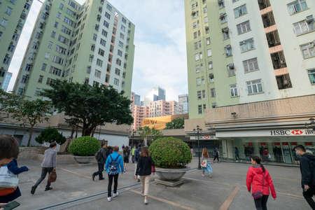 Hong Kong - 2020: Telford Garden Podium, people rush to work, morning cityscape.