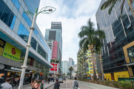 Hong Kong - 2020: Sheung Yuet Road, people on the street, buildings facades.