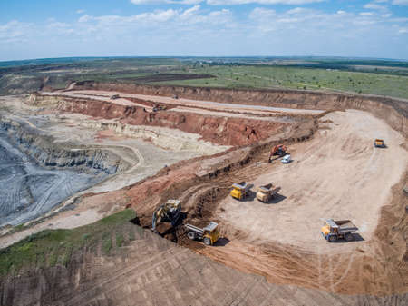 Big quarry, stone mining, equipment for working in quarries, aerial view.