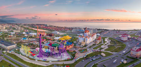 Sochi, Russia - 2016: Sochi Park, attractions, Bogatyr Hotel, sea coast at sunset from above.