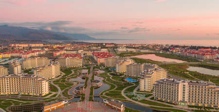 Sochi, Russia - 2016: Sochi Park Hotel from above, modern buildings, beautiful landscape with pond, pergolas, tracks and green grass.