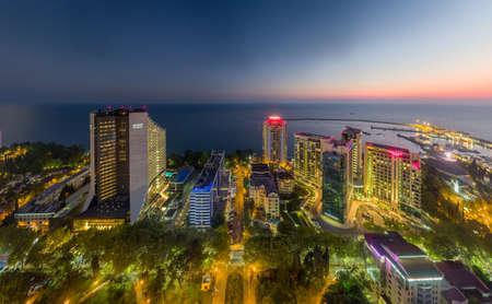 Sochi, Russia - 2016: Sochi center, aerial view. Hyatt Regency hotel, Marins Park Hotel, Aleksandriyskiy Mayak, Mercure Hotel at sunset from above. Editoriali