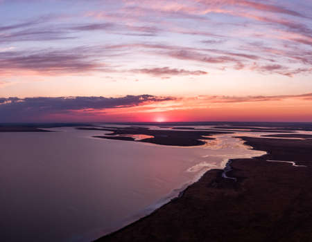 Manych-Gudilo lake at dawn from above. Beautiful pink sky with clouds. Archivio Fotografico
