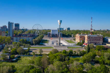 Rostov-on-Don, Russia - 2020: Theatre square, Stela to the liberators of Rostov, aerial view. Empty city, spring day.