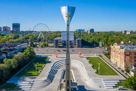 Rostov-on-Don, Russia - 2020: Theatre square, Stela to the liberators of Rostov, aerial view. Empty streets, spring day.