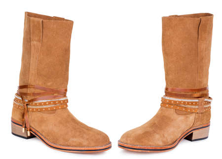 Classic brown red yellow sandy suede leather medium high knee flat heels warm winter comfort female woman women boots. Two isolated Archivio Fotografico - 129678359