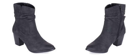 Pair of classical black woman high ankle cowboy suede boots shoes. Two isolated. Banque d'images