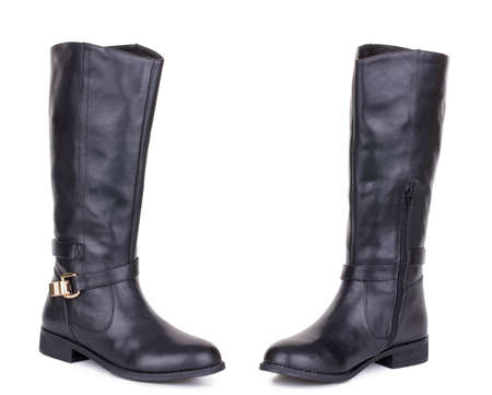 Classic black glossy leather high knee flat heels female boots. Two isolated Banque d'images