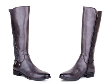 Classic brown glossy leather high knee flat heels female boots. Two isolated Archivio Fotografico - 129678704