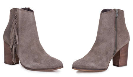 Pair of classical woman cowboy suede boots shoes. Two isolated. 免版税图像
