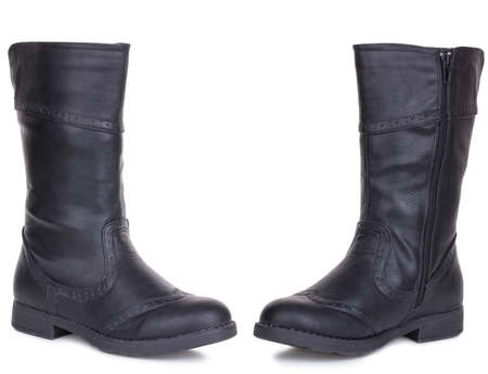 Classic black glossy leather high knee flat heels female boots. Two isolated Archivio Fotografico - 129678906