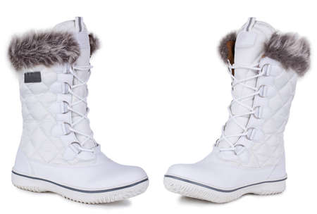 A pair of white leather suede woolen woman winter boots. Two isolated
