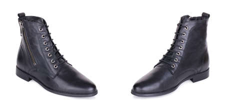 Pair of stylish classical laced black woman polished leather flat high ankle boots shoes. Two isolated. Banque d'images