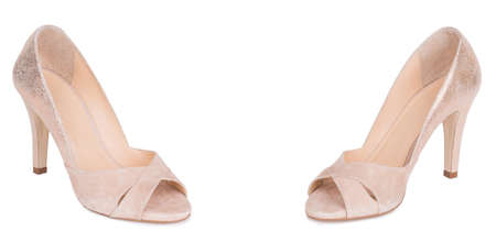Pair of classical daily beige woman stylish high heels shiny suede peep toe shoes. Two isolated.