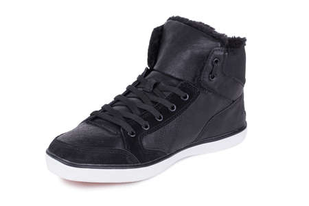 One black laced breathing orthopedic leather casual hipster style 80s 90s style ankle sneakers shoe isolated on white background