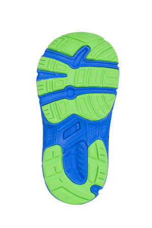 Sole of sport tracking shoes snickers individual design close up isolated one stylish blue and green pattern