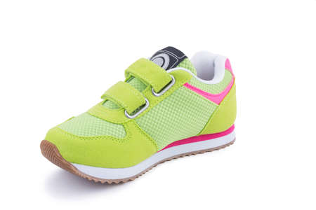 One colorful bright green leather fiber, fabric breathing children laced orthopedic footwear snickers shoe boot isolated