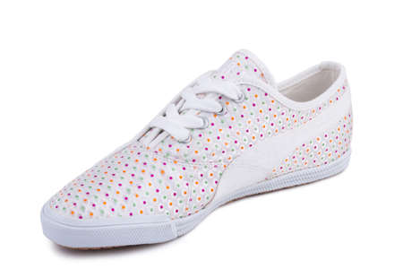 One white pink and green dotted patternfiber fabric laced breathing orthopedic casual sneakers shoe isolated on white background