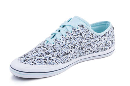 One blue floral pattern fiber fabric laced breathing orthopedic casual sneakers shoe isolated on white background
