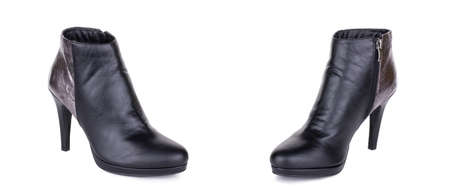 Pair of stylish classical black woman leather high ankle boots shoes. Two isolated. Banque d'images