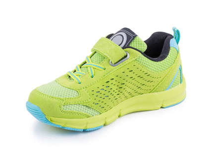 One colorful bright green leather fiber, fabric breathing children toddler laced orthopedic footwear snickers shoe boot isolated