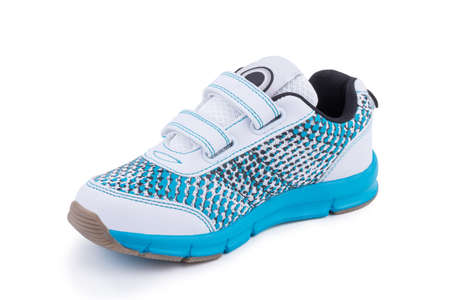 One white blue sole bright leather fiber, fabric toddler laced orthopedic footwear snickers shoe boot isolated
