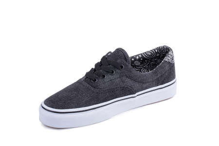 One grey fiber fabric laced breathing orthopedic casual sneakers shoe isolated on white background. Gangster concept Stockfoto