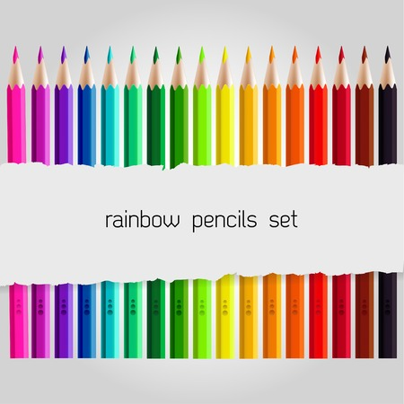raged: Big coloured pencil set with piece of torn paper over