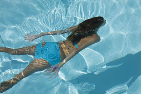 pool preteen: Model Release 358  Young girl swimming under water Stock Photo