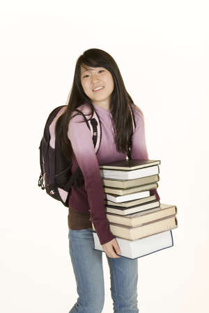 Model Release 363  Asian teenage loaded down with school books