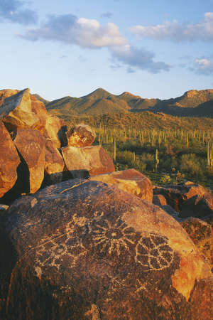 Petroglyphs on Signal Hill with the Tuson Mountaians in the background. Saguaro National Park, Arizona...The petroglyphs were most likely created by the Hohokam People between 700 and 1300 years ago