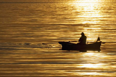 Early morning light on fisherman Stock Photo - 645454