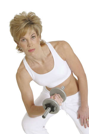 MR# 267 Woman in mid 20s working out with dumbells photo