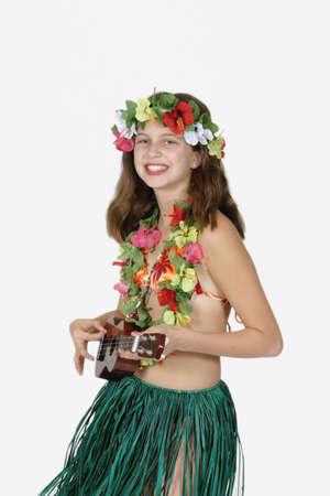 Preteen girl dressed as Hula girl Фото со стока