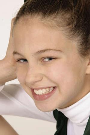 Preteen girl dressed as cheerleader photo