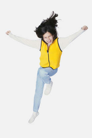 Preteen jumping on white background photo