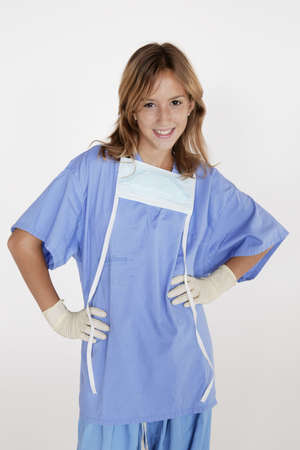 Portrait of preteen playing Doctor / Nurse Stock Photo - 656424