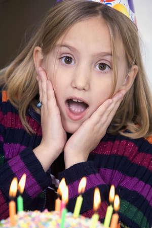 Eight year old girl having a birthday party Reklamní fotografie