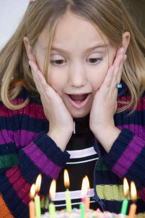 suprise: Eight year old girl having a birthday party Stock Photo