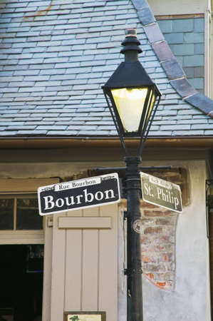Bourbon Street sign with the haunted Lafittes Blacksmith Shop in the background, New Orleans, Louisiana Imagens