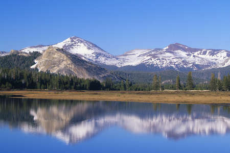 the mountain range: Mountain range reflected in alpine lake Stock Photo