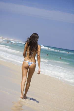 brazilian woman: Beautiful young Brazilian woman walking along Copacabana Beach in Rio de Janeiro in Brazil