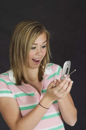 Model Release #271  15 year old teenage girl looking surprised on cell phone photo