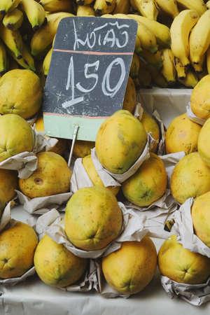 Bananas and papayas for sale iin a street market in Rio de Janeiro, Brazil