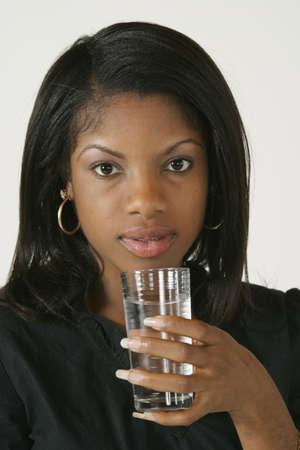 early 20s: Modelo Release # 278 African American Woman 20 a principios del agua potable  Foto de archivo