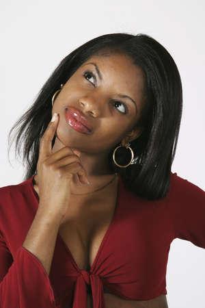 early 20s: Modelo Release # 278 African American mujer en poco m�s de 20 a�os pensamiento  pregunto  Foto de archivo