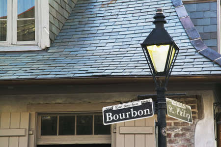 blacksmith shop: Bourbon Street sign with the haunted Lafittes Blacksmith Shop in the background, New Orleans, Louisiana Stock Photo